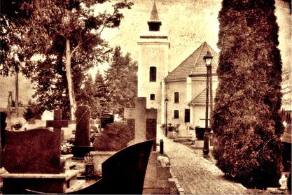 Obsługa cmentarzy i usługi cmentarne w Iławie. Zdjęcie kościoła we Frednowych i pobliskiego cmentarza.